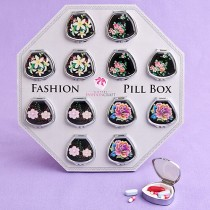 Fan-shaped pill boxes in colorful floral designs