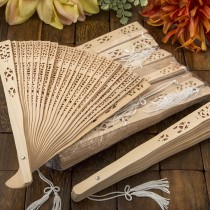 Intricately carved Sandalwood fan favors from fashioncraft