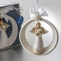 Guardian Angel ornament with ornate star and holding a heart